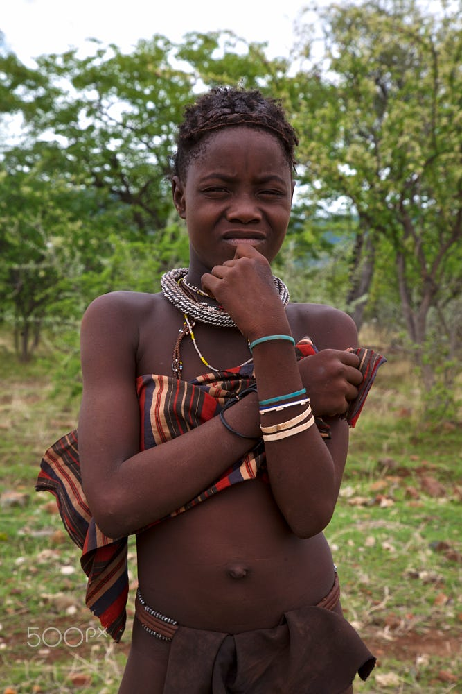 Portrait of a young teenager of the Himba tribe, Namibia